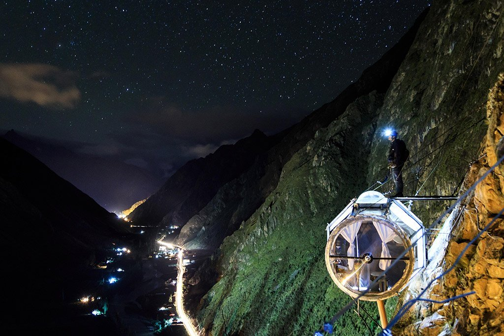 hanging hotel at night in peru luxsphere travel
