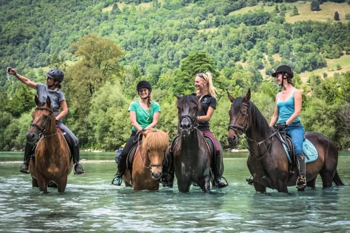 horse riding in lake bled