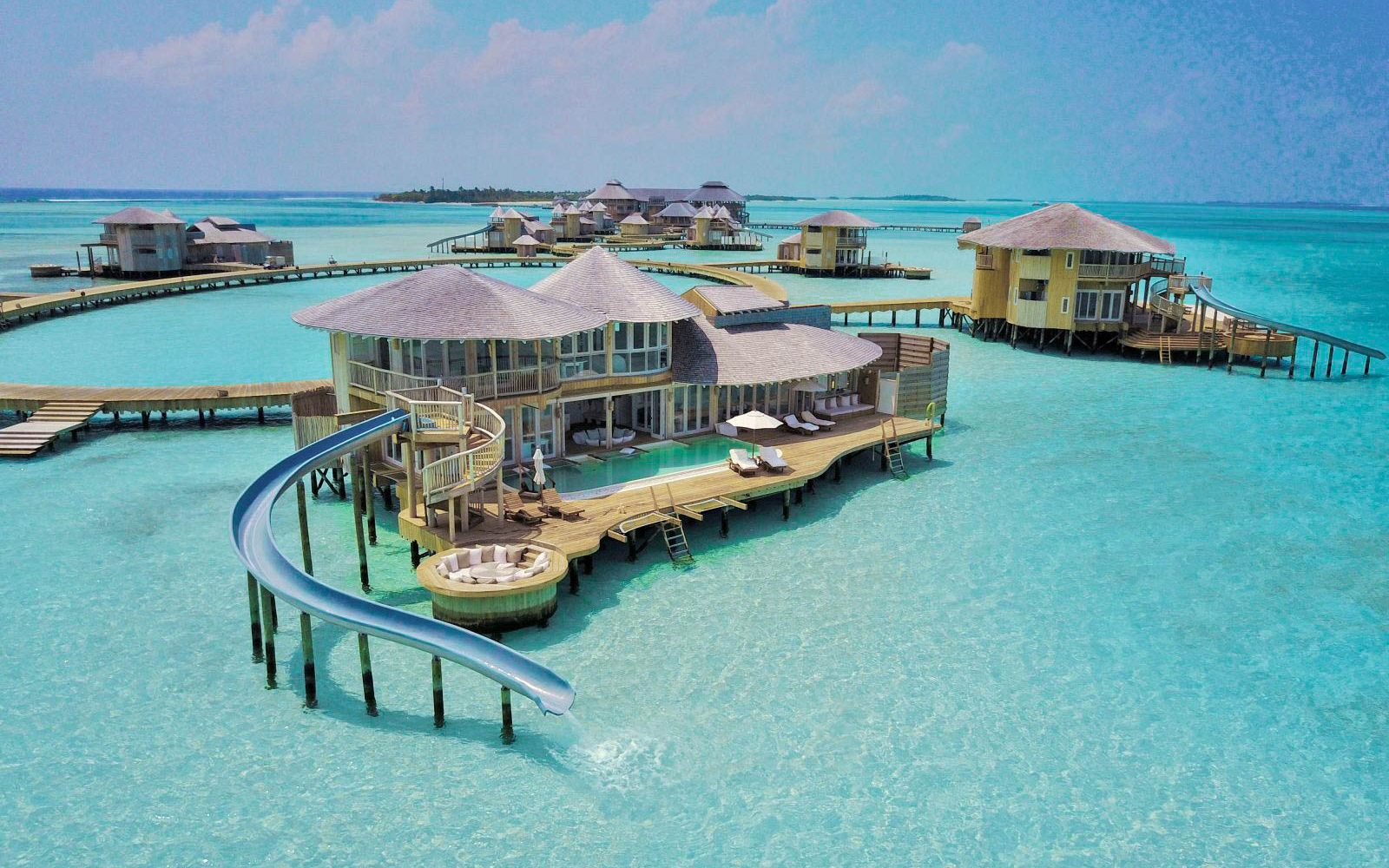 Waterslide that goes into the Indian Ocean from your villa Maldives